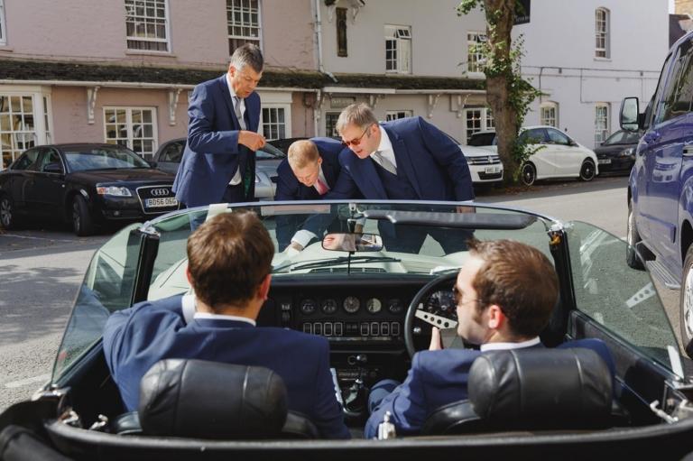 oxfordshire wedding photography groomsmen in wedding car