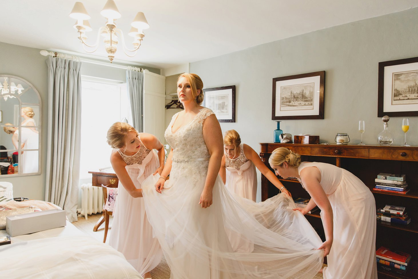 oxfordshire wedding photography bridesmaids with brides dress
