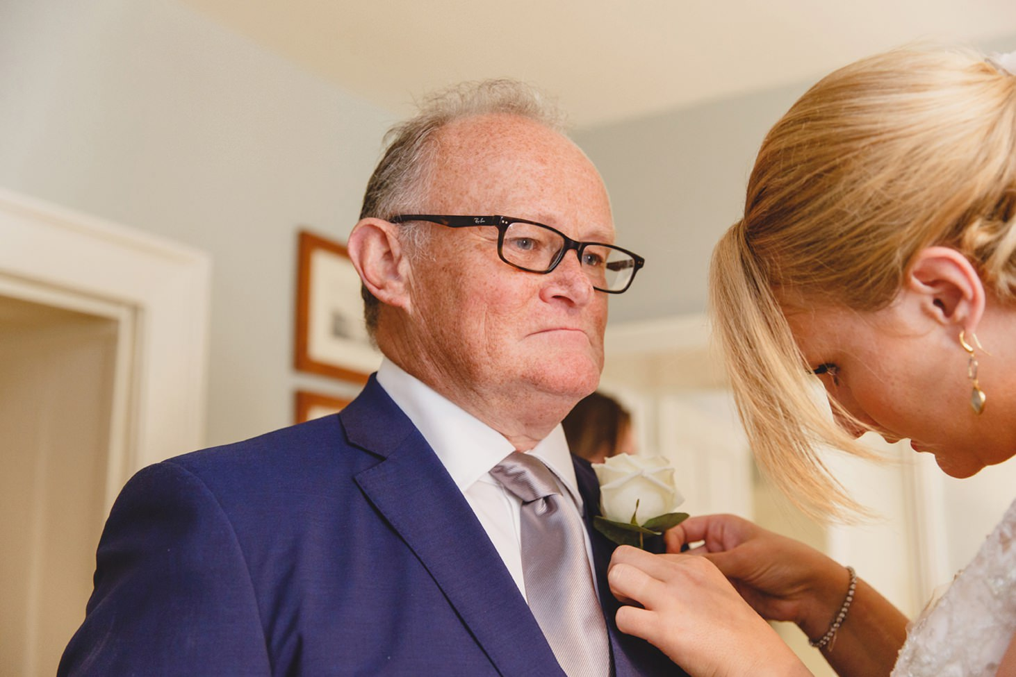oxfordshire wedding photography bride pinning fathers buttonhole