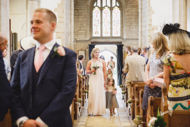 oxfordshire wedding photography bridesmaids in church aisle