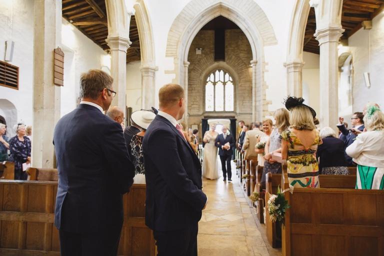 oxfordshire wedding photography groom watching bride