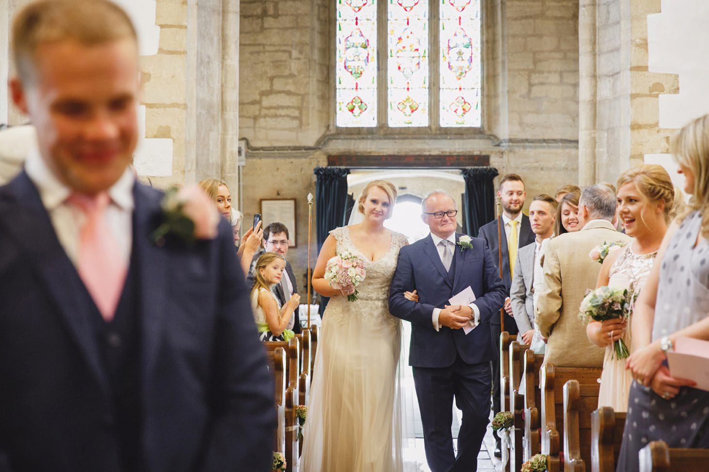 oxfordshire wedding photography bride walking down the aisle