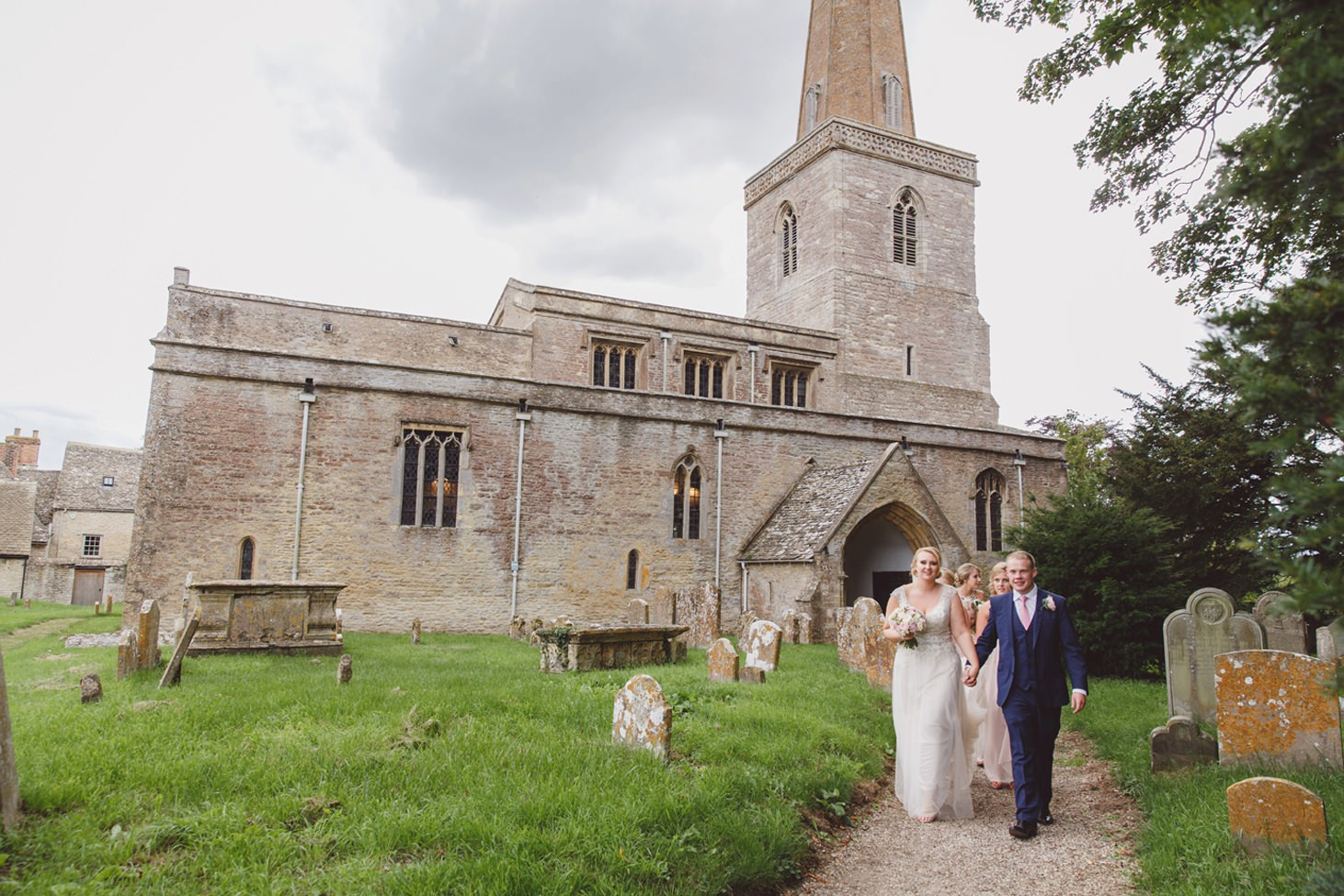 oxfordshire wedding photography bride and groom leave church