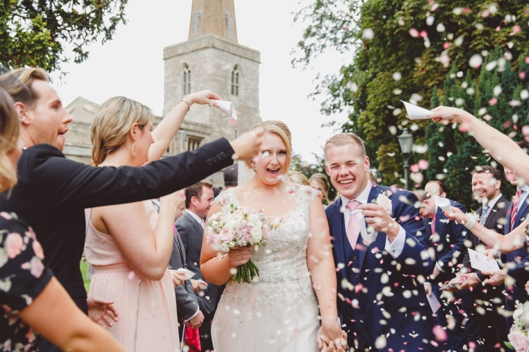 oxfordshire wedding photography bride and groom in confetti