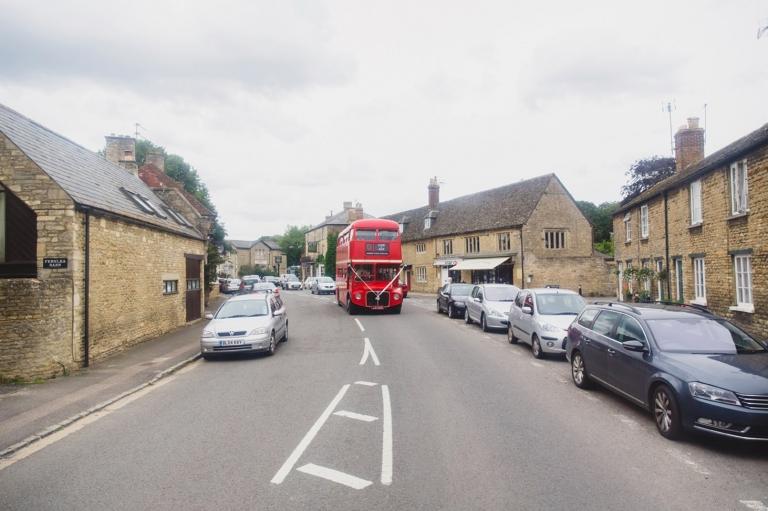 oxfordshire wedding photography bus driving through village