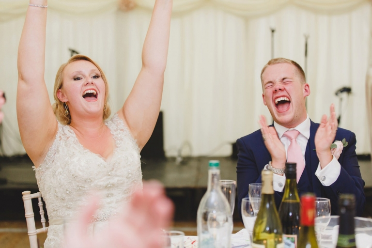oxfordshire wedding photography bride and groom cheering