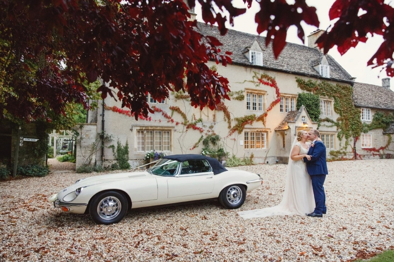 oxfordshire wedding photography bride and groom with wedding car
