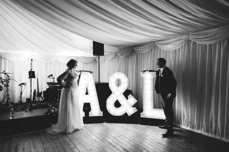 oxfordshire wedding photography bride and groom with light up letters