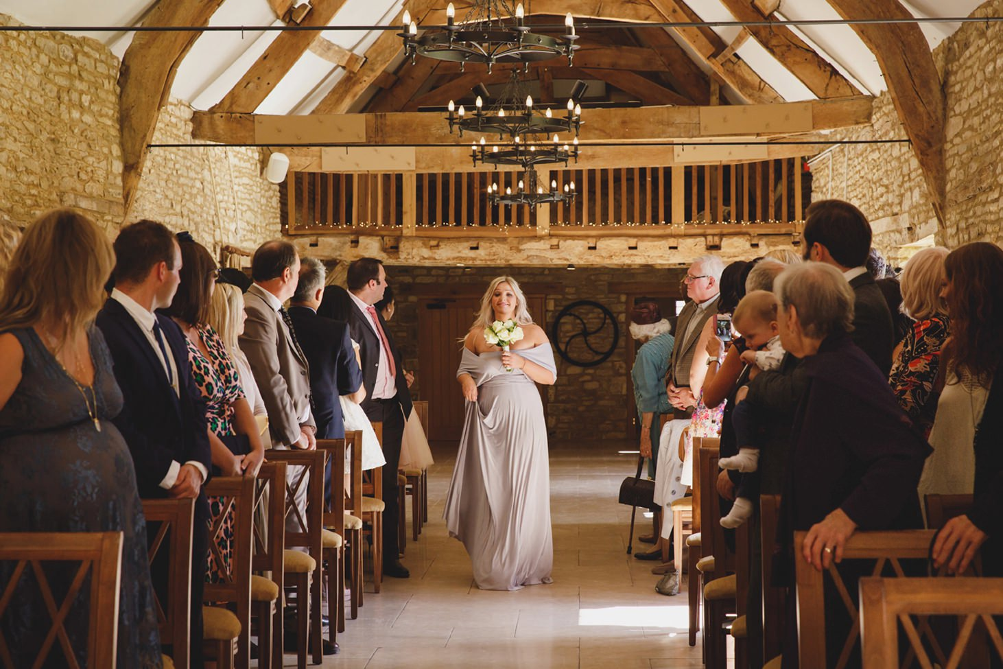 Caswell House wedding photography bridesmaid walking down aisle