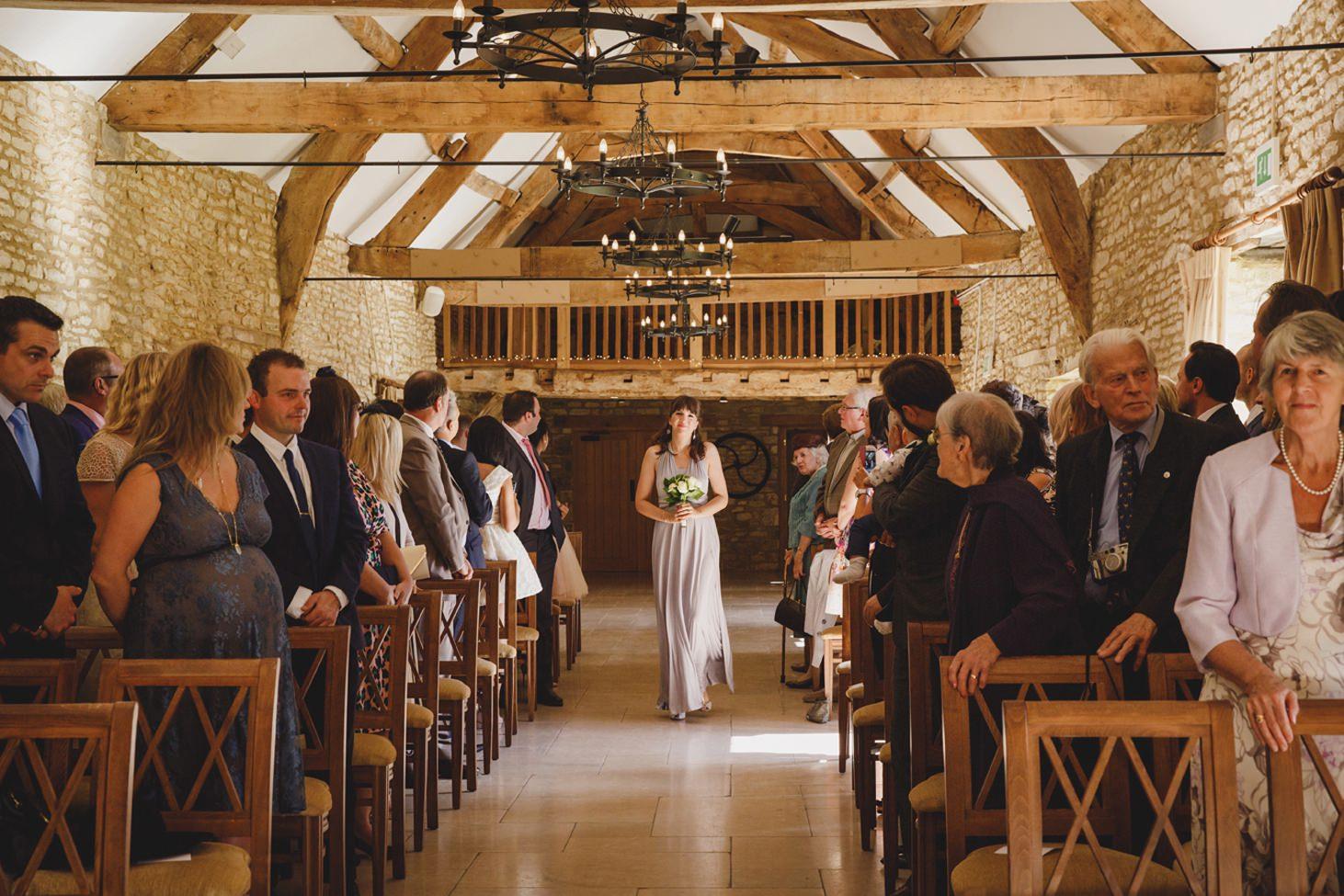 Caswell House wedding photography aisle bridesmaid