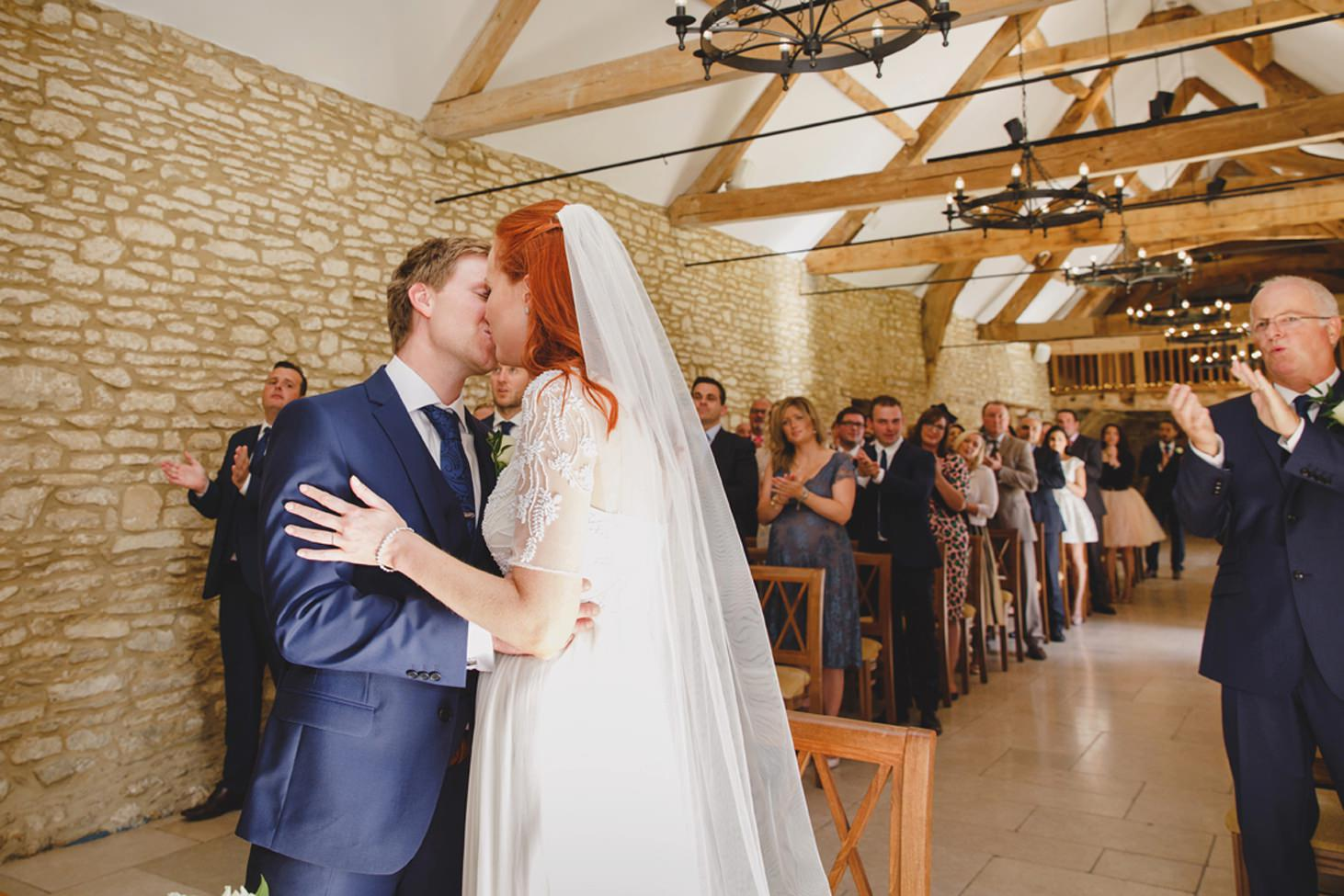 Caswell House wedding photography first kiss