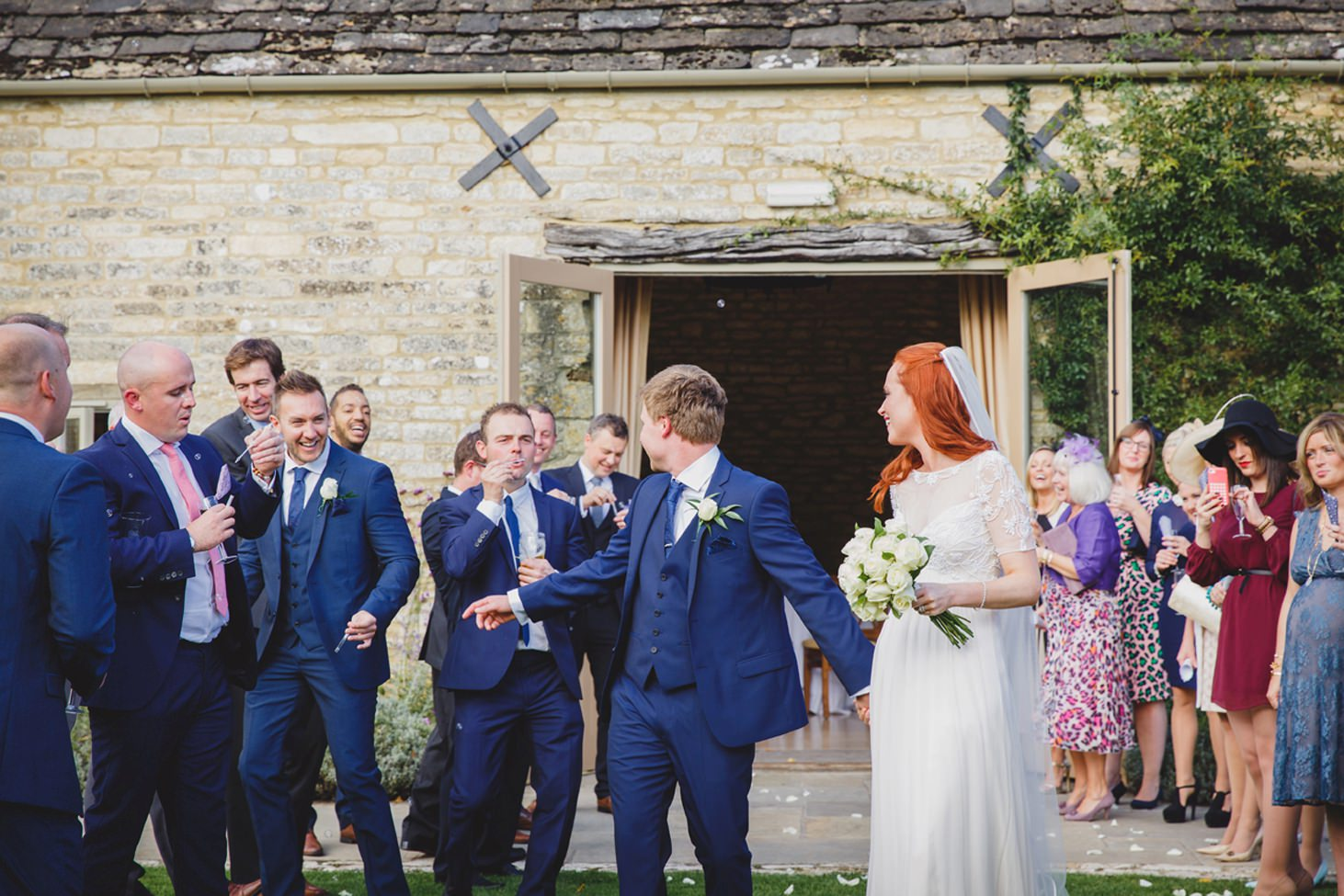 Caswell House wedding photography bride and groom with bubbles