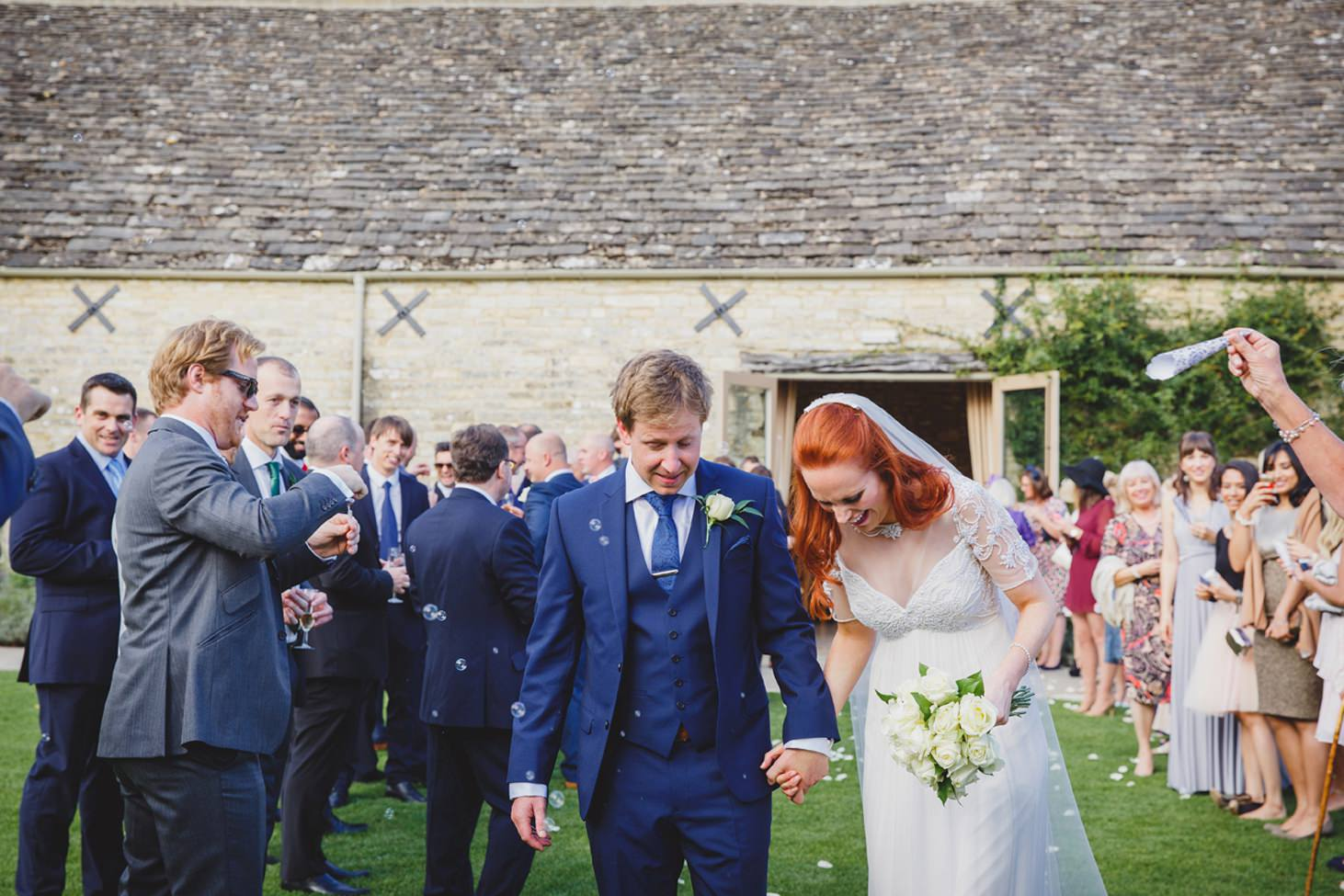 Caswell House wedding photography walking through confetti