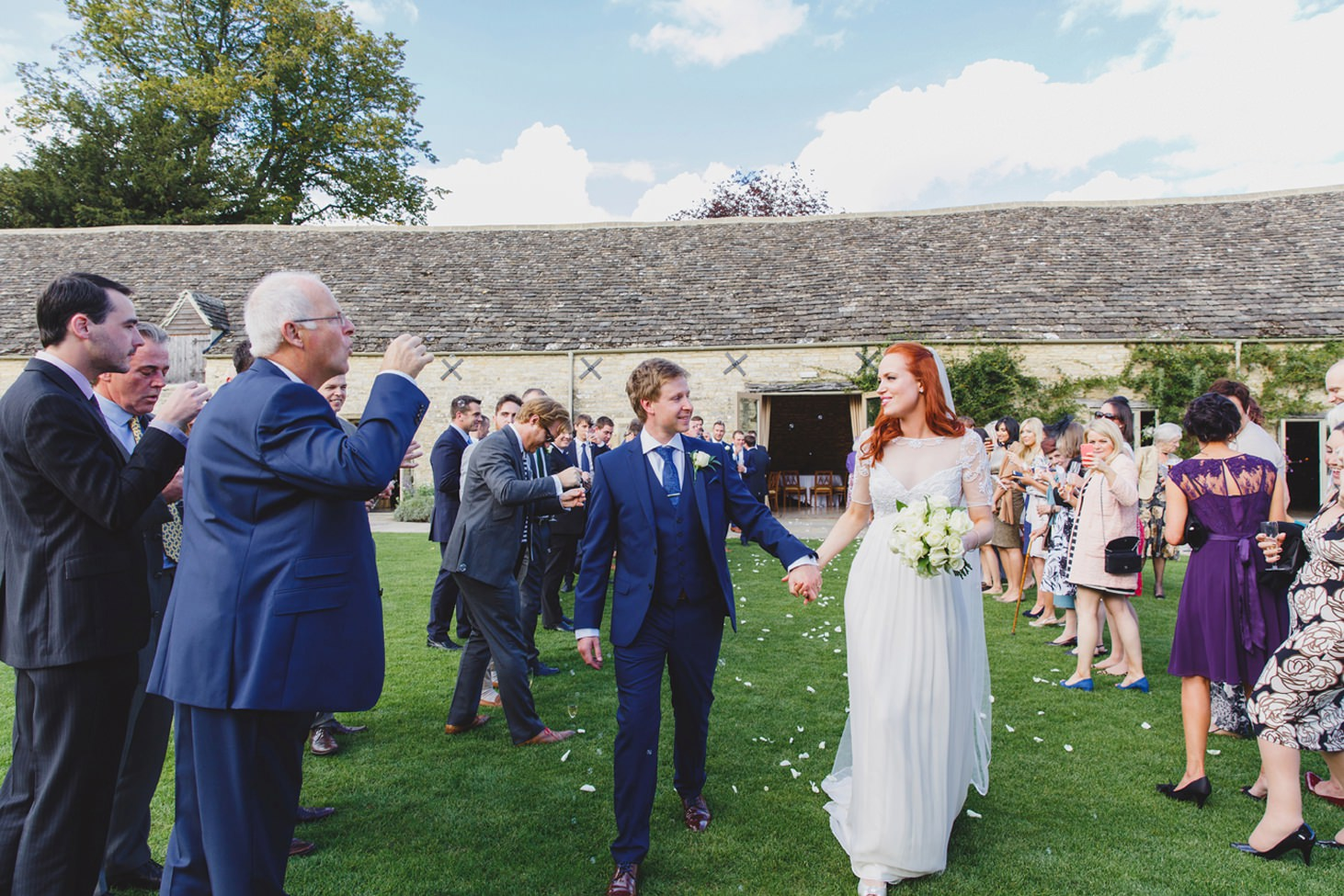 Caswell House wedding photography bride and groom with confetti and bubbles