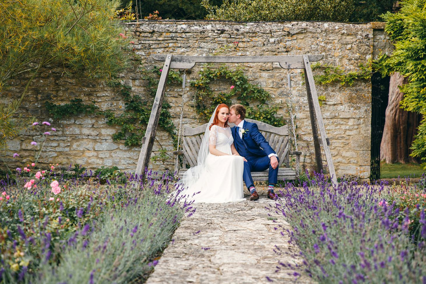 caswell house wedding photography bride and groom on garden seat