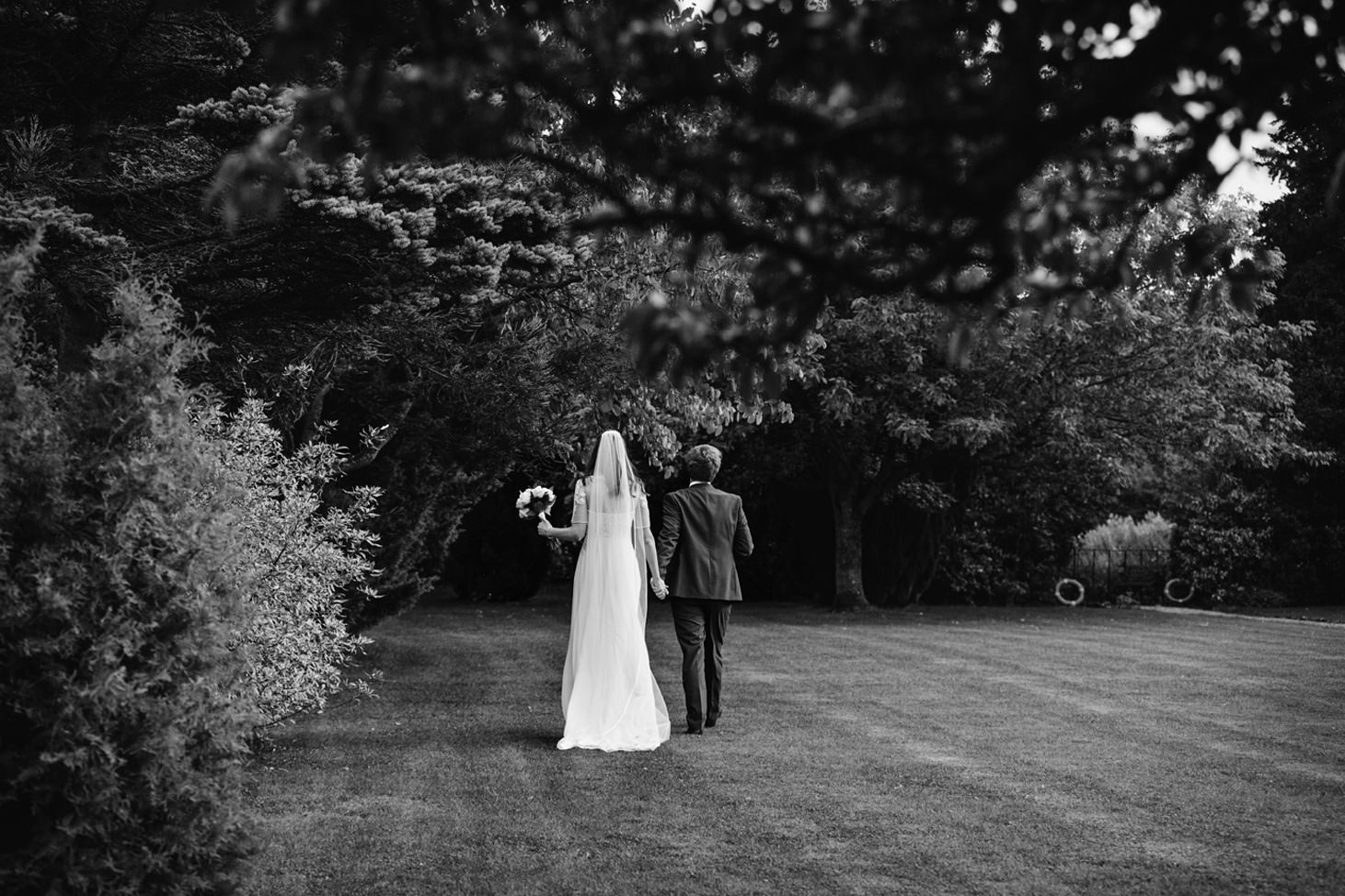 caswell house wedding photography bride and groom walking in garden