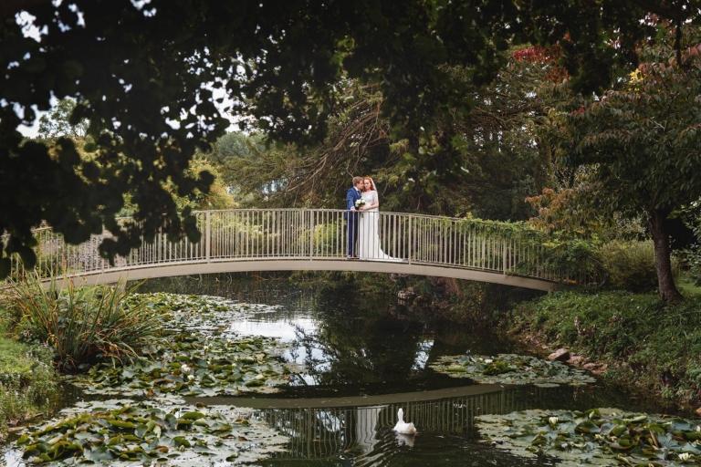 caswell house wedding photography bride and groom on bridge