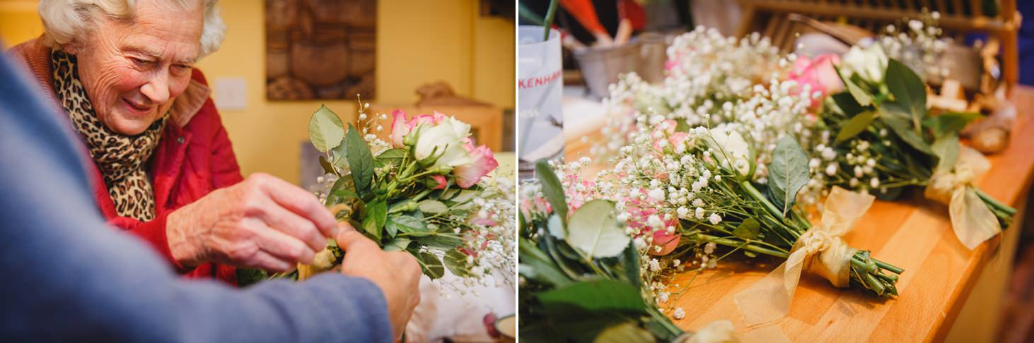 Bodleian library wedding tying flowers