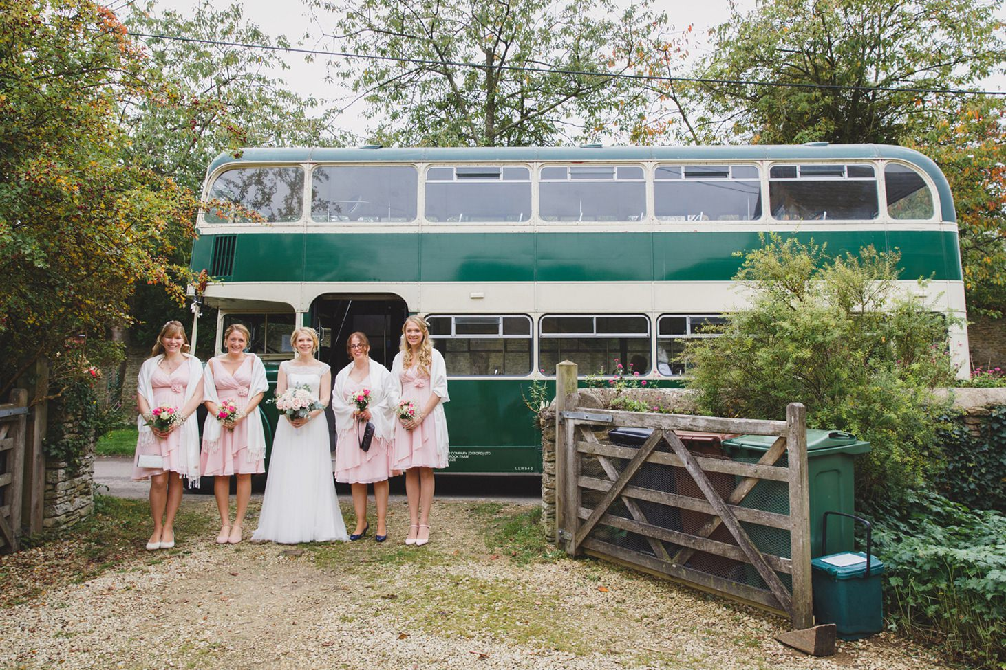Bodleian library wedding bride and bridesmaids with vintage bus