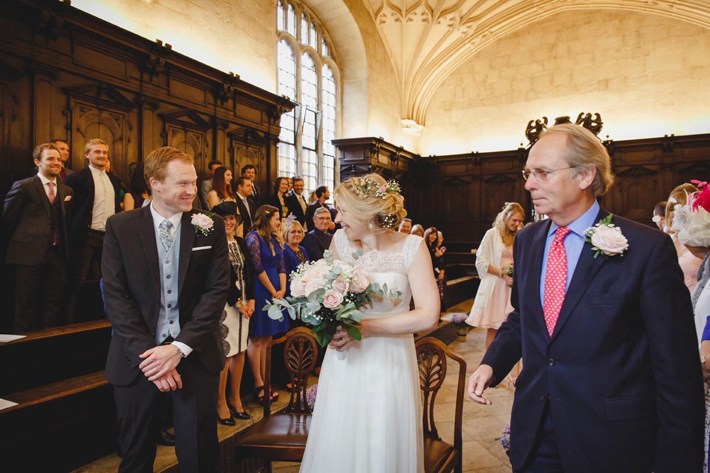Bodleian library wedding bride greets groom