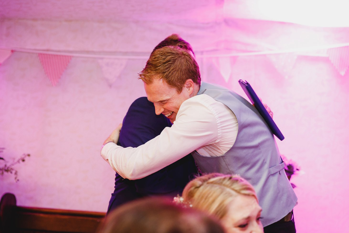 Bodleian library wedding groom and best man hugging