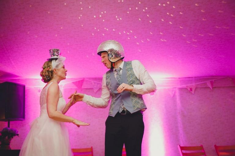 Bodleian library wedding bride and groom in glitter helmets