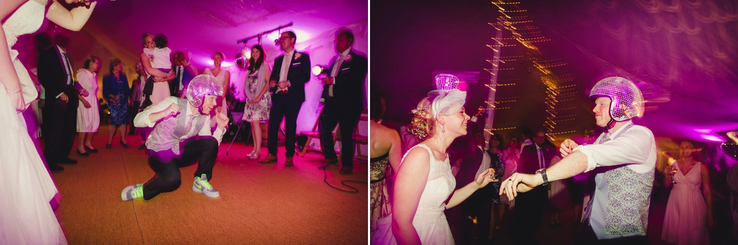 bride and groom in disco ball helmets