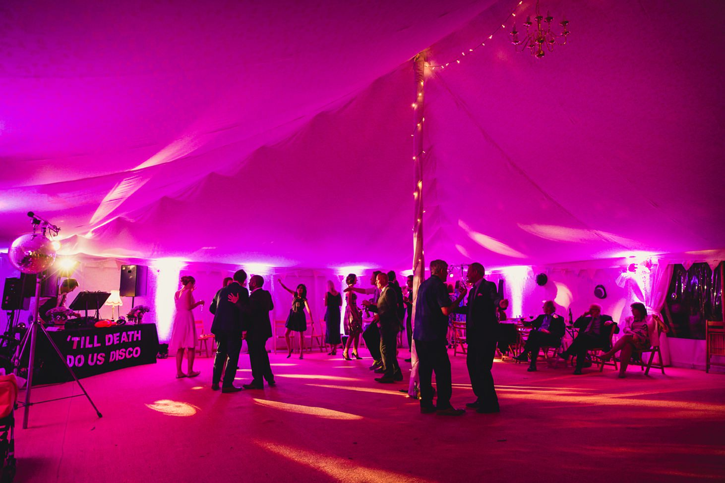 Bodleian library wedding wedding guests in the tent at the perch pub wedding reception oxford