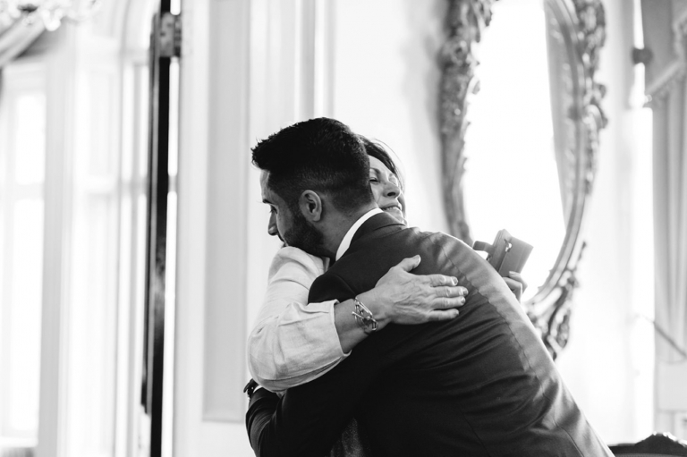 Down Hall hotel wedding photography groom hugging his mum