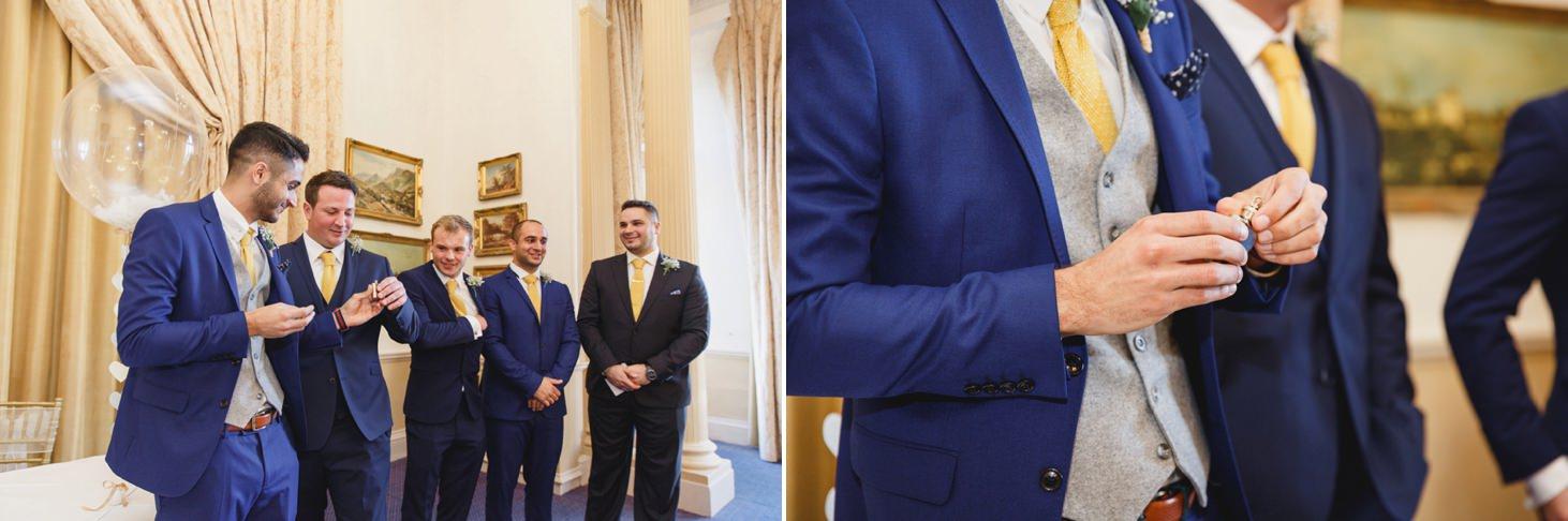 Down Hall hotel wedding photography groom with hip flask