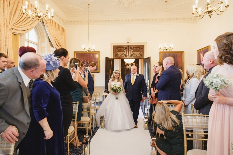Down Hall hotel wedding photography bride walking down aisle