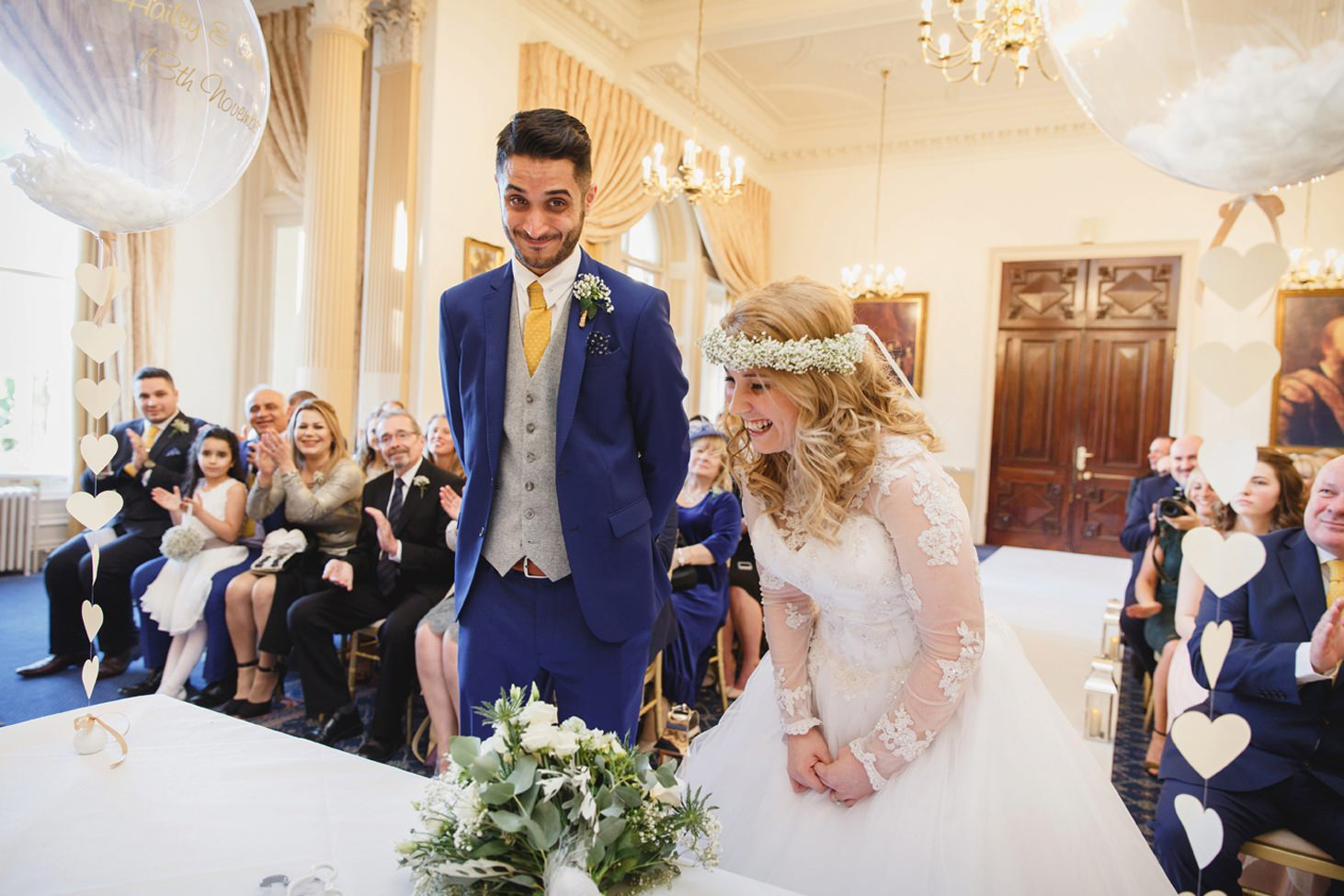 Down Hall hotel wedding photography bride and groom laughing