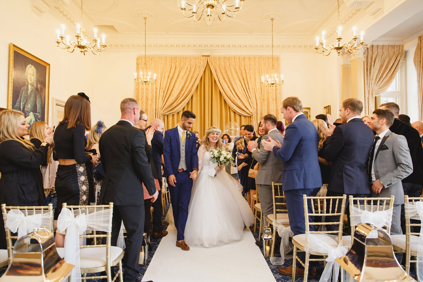 Down Hall hotel wedding photography bride and groom walking down aisle