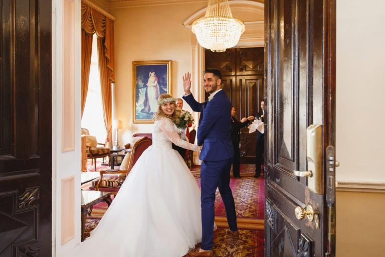 Down Hall hotel wedding photography bride and groom waving