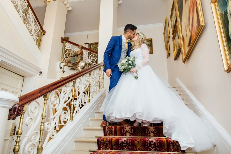 Down Hall hotel wedding photography bride and groom on stairs