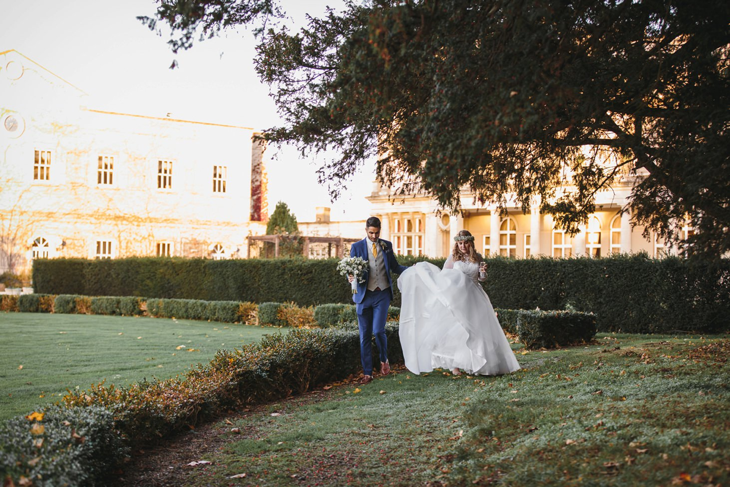 Down Hall hotel wedding photography bride and groom walking in gardens