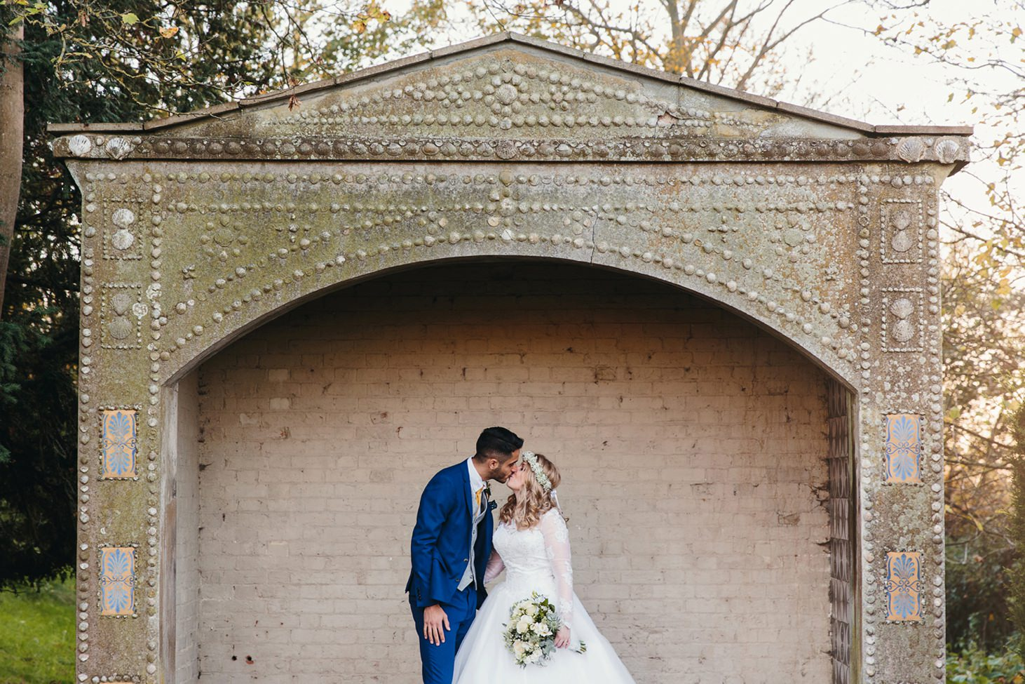 Down Hall hotel wedding photography groom and bride kiss