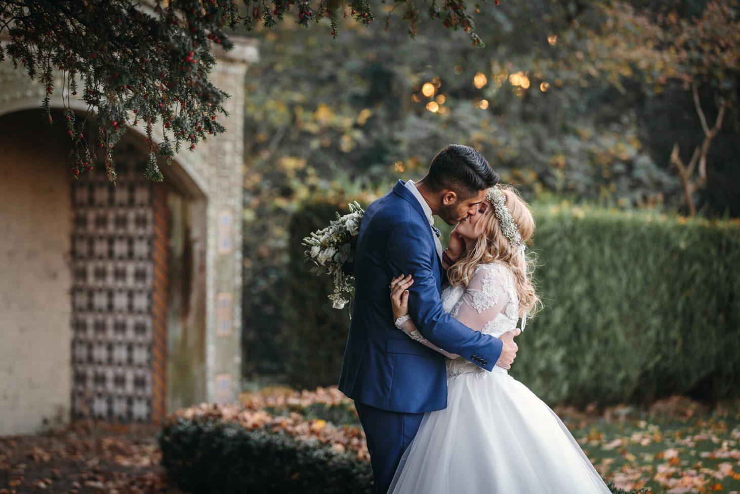 Down Hall hotel wedding photography bride and groom kissing in gardens