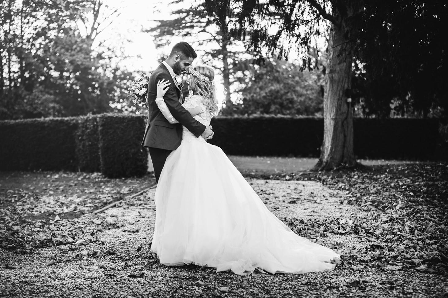 Down Hall hotel wedding photography wedding couple kissing