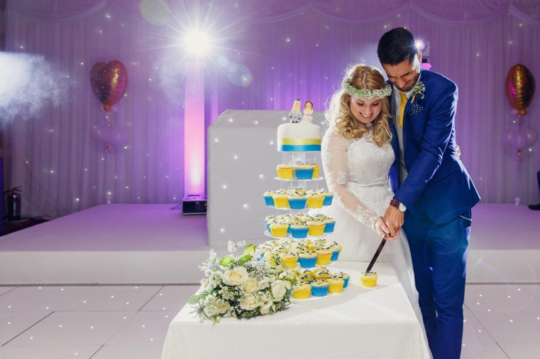 Down Hall hotel wedding photography cutting minions wedding cake
