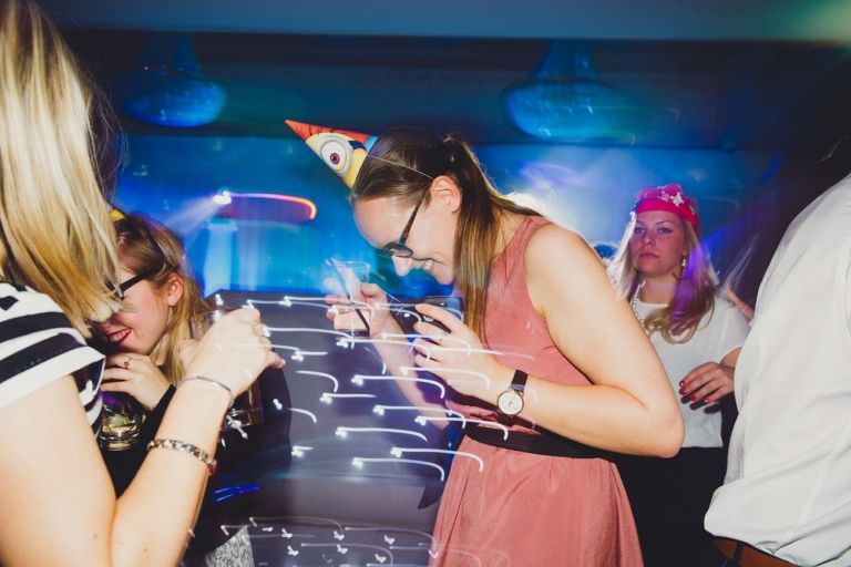 Down Hall hotel wedding photography guest dancing in minions hat