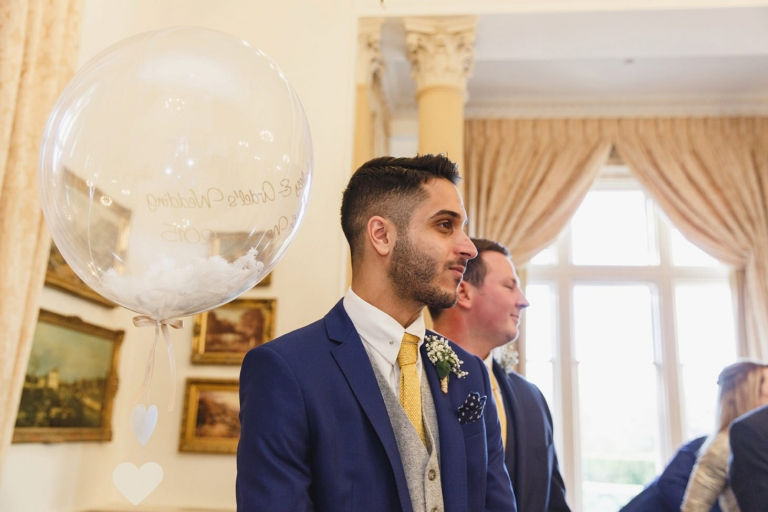 down hall hotel wedding photography groom waiting for bride