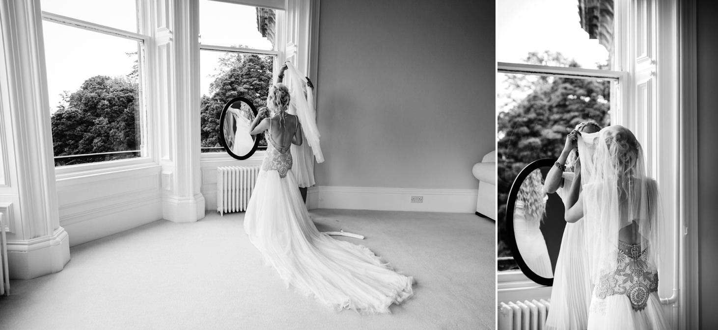 mount stuart wedding photography bride putting on veil