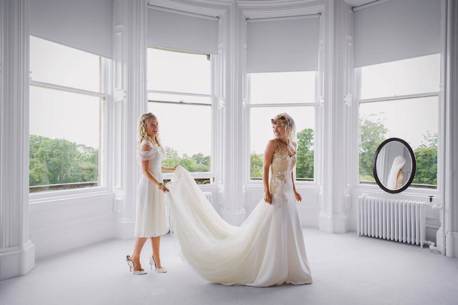 mount stuart wedding photography bride and bridesmaid with dress