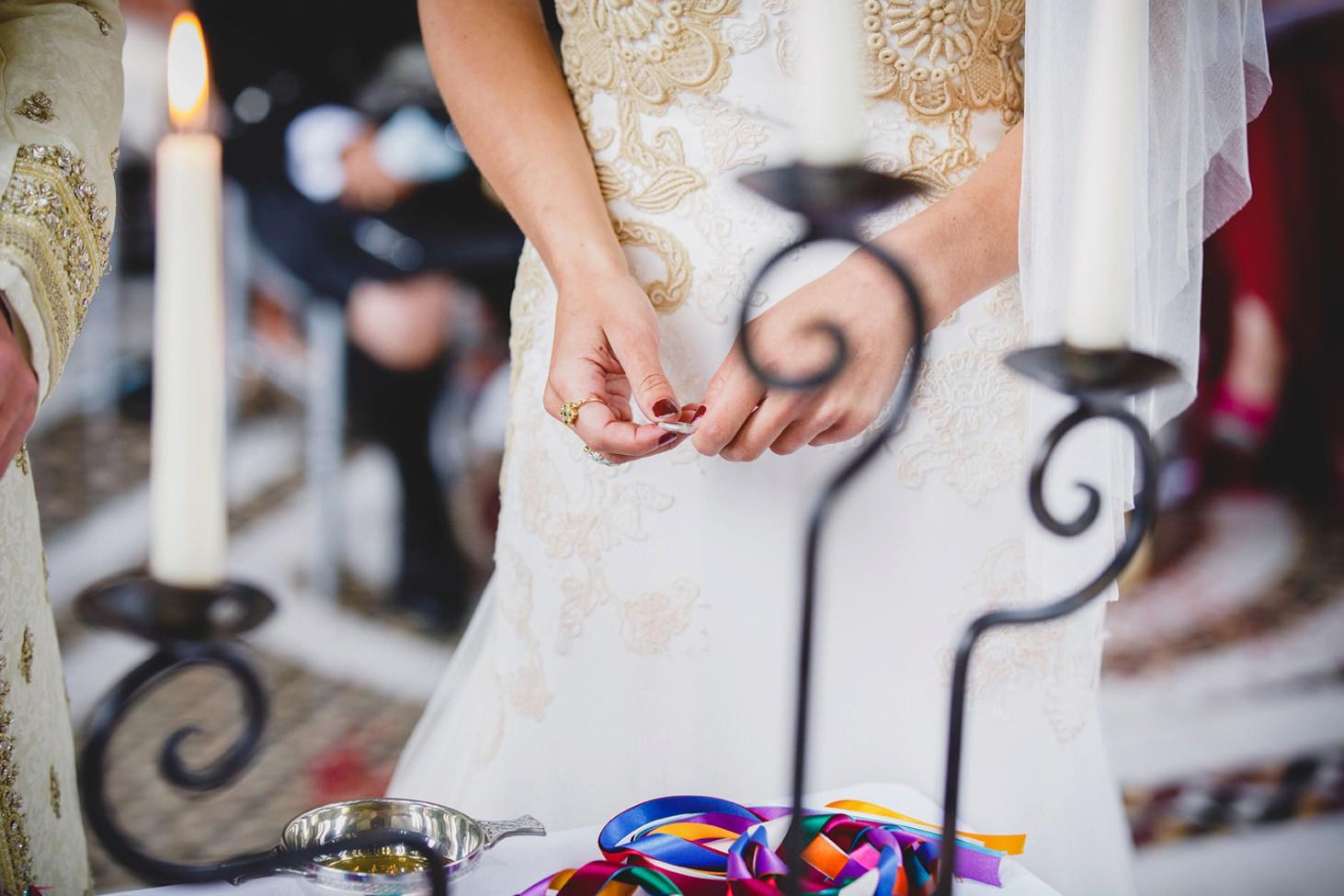 mount stuart wedding photography bride holding ring