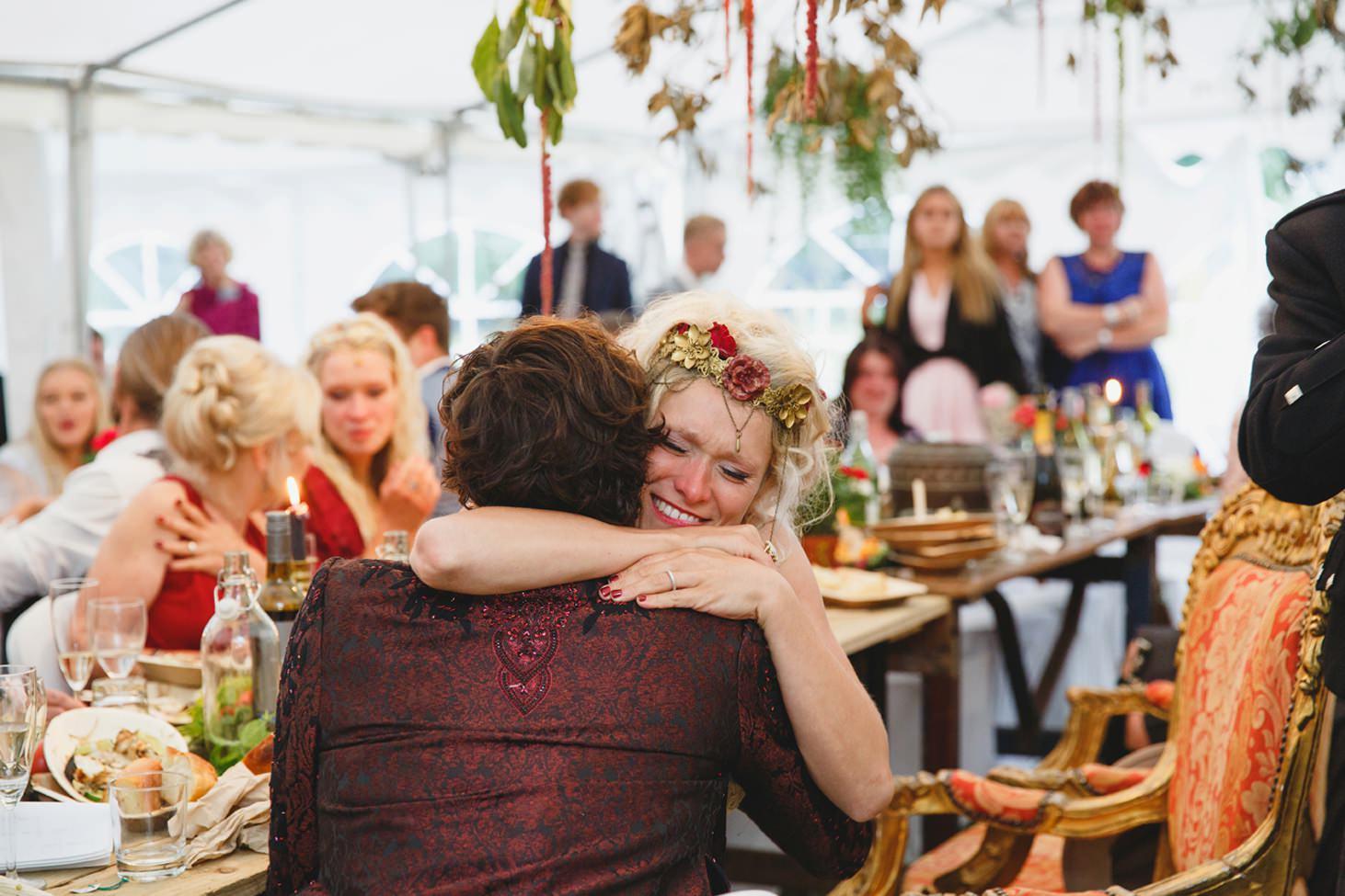 mount stuart wedding photography bride hugging best man
