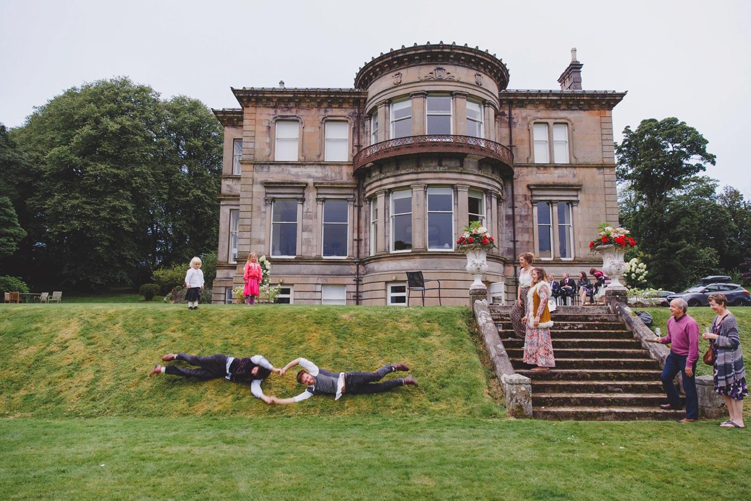 mount stuart wedding photography guests rolling down hills