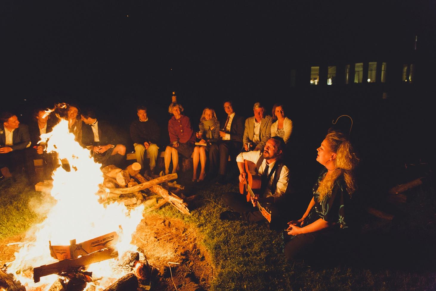 mount stuart wedding photography singing round bonfire