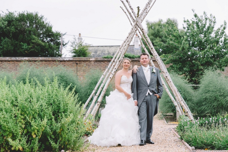 Fun natural wedding photography at South Lodge Hotel Horsham bride and groom kitchen garden