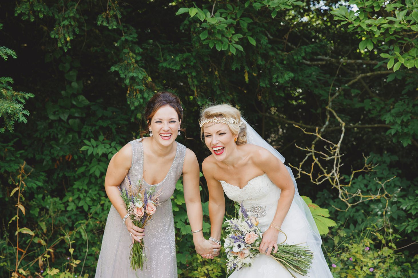 The Rectory Hotel Crudwell bride and bridesmaid laughing